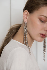 The Jupe, a pair of drop earrings in Sliver. Delicate chain design with cubic stud. Post back. Sold as a set.