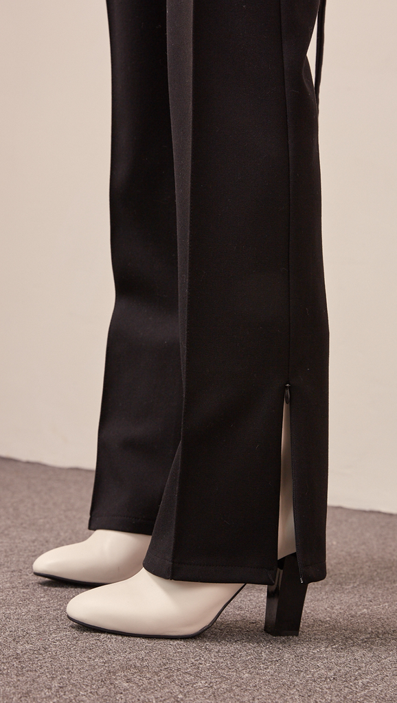 The Luna pant in back open with self-tie, cut out detailing and zip opening at hem. Zip fastening along side. High rise.