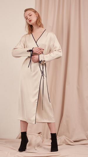 The Gabe Dress in Ivory. With wrap front, self-tie at waist. Lightweight. Super soft feel. Midi length, particularly long in length.
