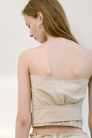 The Keria top in bustier with hook and eye front closure with attached sash belt. Partial elasticated band at back.