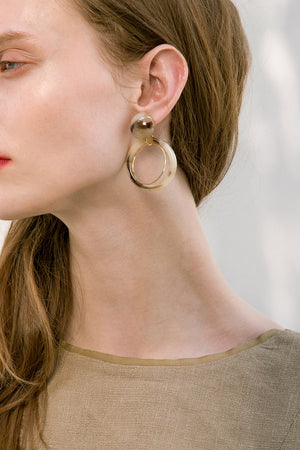 The Koh, a pair of porcelain round drop earrings. Gold metal post back. Sold as a set.