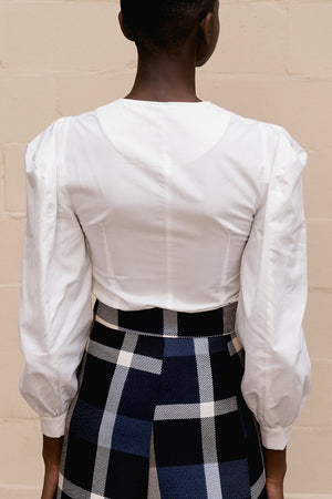The Larkin top featuring round neckline, gathered button down closure at front, long sleeves with ruched cuffs. Pull on.