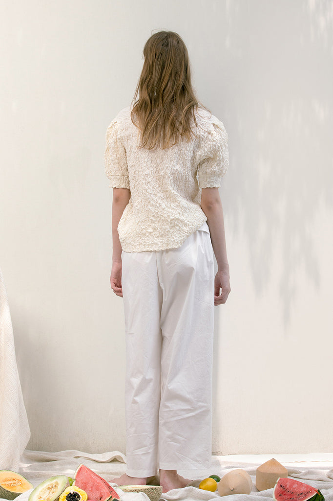 The Lassie Pant in white featuring elastic waistband, two slant pockets. Lightweight.