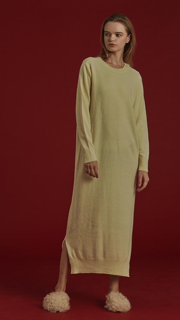 Latt Knit Dress in lime-yellow, with a stretch super soft wool. Button detailing along neckline. Pull on. Designed to be loose fit. Extra long in length.