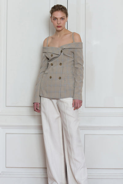 Lauri off the shoulder blazer feature baring off the shoulder cut with an elegant neckline. Double breast wood coloured hardware closure. Light-weight.