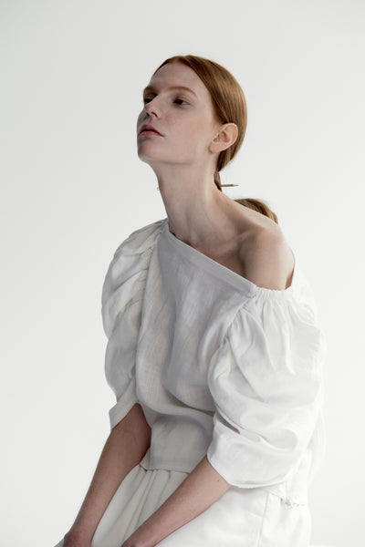 The Lazaro Top in White featuring ruched quarter sleeve with square neckline, cinching pleated detailing. Pull on.