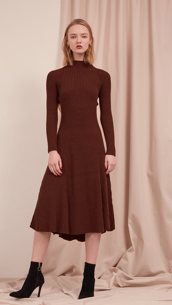 The Leila Dress in Dark Mocha. With ribbed midi dress with cut out back and white cotton tie open back. A-line shape. Slightly loose fit. Mid-weight. Stretchy fabric.