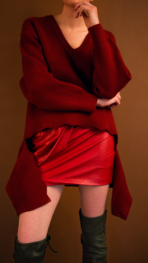 The Fallen Skirt in burgundy. With a bow detailing, concealed zip closure along side. Mini length. Lightweight.