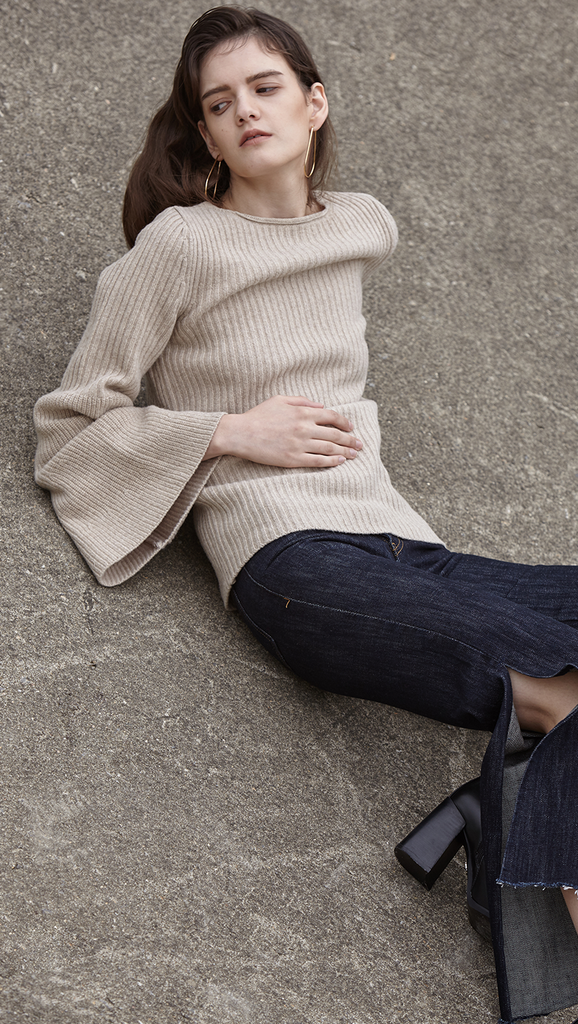 Reia Knit in oatmeal beige, a wide bell sleeves ribbed knit with crewneck, drop shoulder. Relaxed. Pull on.