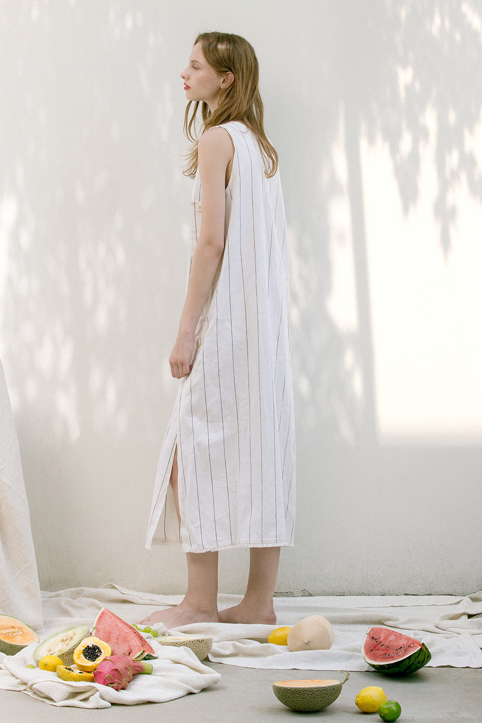 The Louis pin stripe dress in round neckline, sleeveless, side slits. Pull on. Particularly long in length.