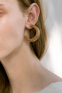 The Lucia, a pair of acetate hoop earring. Metal post back. Sold as a set.