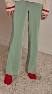 Lyla Trousers in Mint. Silky panelling with no pockets and elasticized waistband. Peg cut of tapered light-weight trousers. Designed to sit on the natural waist.