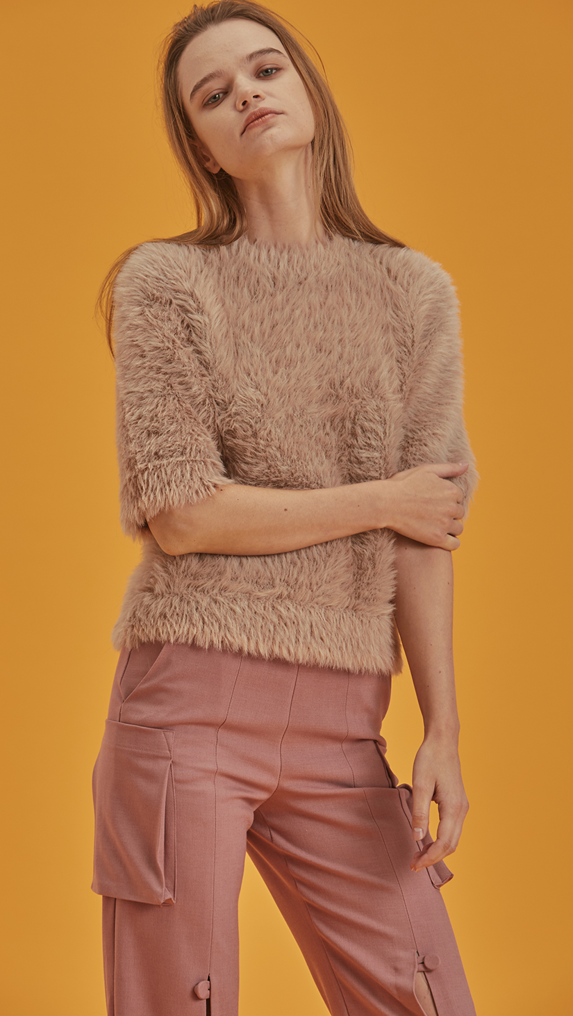 Short sleeved pullover with statement furry in matte pink. Soft feel texture. Furry interior. Pull on.