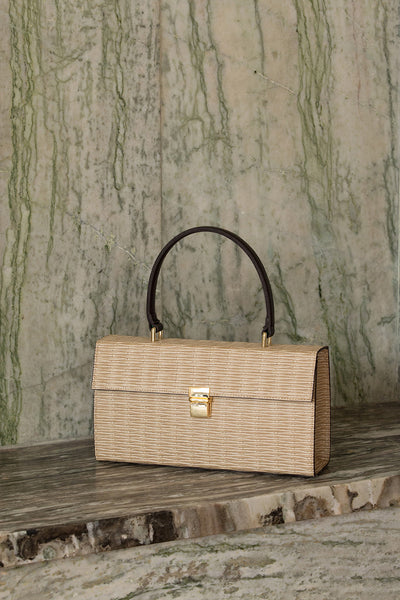 Malmo rattan bag in Beige. Top carry handle. Main compartment with front flap magnetic snap tab closure. Detachable shoulder straps.