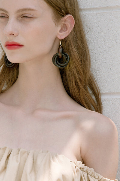 The Marcello, a pair of doorknocker linked drop earrings in Dark Brown. Metal hooks back. Sold as a set.