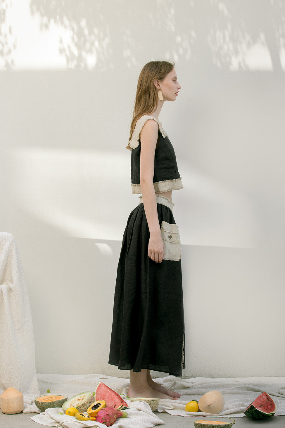 The Maretta Skirt featuring raw edge pocket and concealed side zip closure.