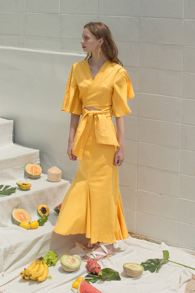 The Martyna Skirt in Yellow featuring ruffle pleats in fluted edge, concealed side zip closure, high waist in ankle length. Partial lined.