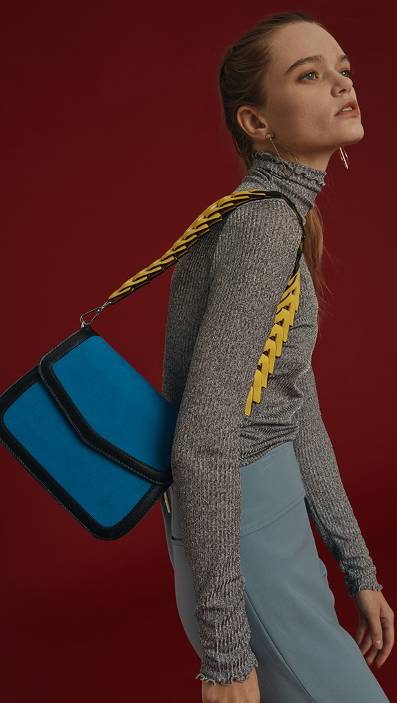 Velda shoulder bag in Blue. Clean lines. Mini square silhouette. Main compartment with magnetic top flap, interior with a zip compartment with card compartments at side, fully lined and non-adjustable shoulder strap - Two different version of straps included (sliver chain and contrasted colour shoulder strap)