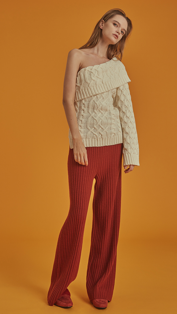 The Mikaela Pant is brick wool trousers sit high on the waist with an elasticated ribbed-knit trim. Wide leg cut. No pockets. Relaxed fit. Wholegarment Made.