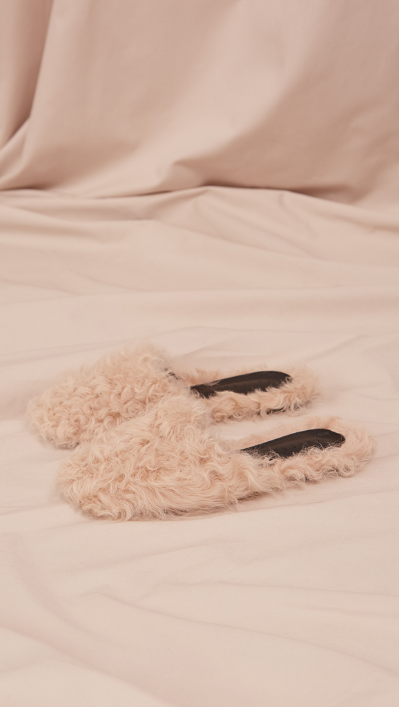 Études Furry Slide in Ivory Shearling. Shearling mule, created entirely with curly lambs wool. Slide loafers with a round square toe, padded leather foot bed and rubber soles. Slip on.