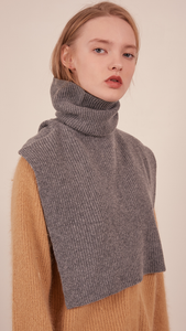 The Muir Turtleneck Knit in grey with no sleeves. Pull on.