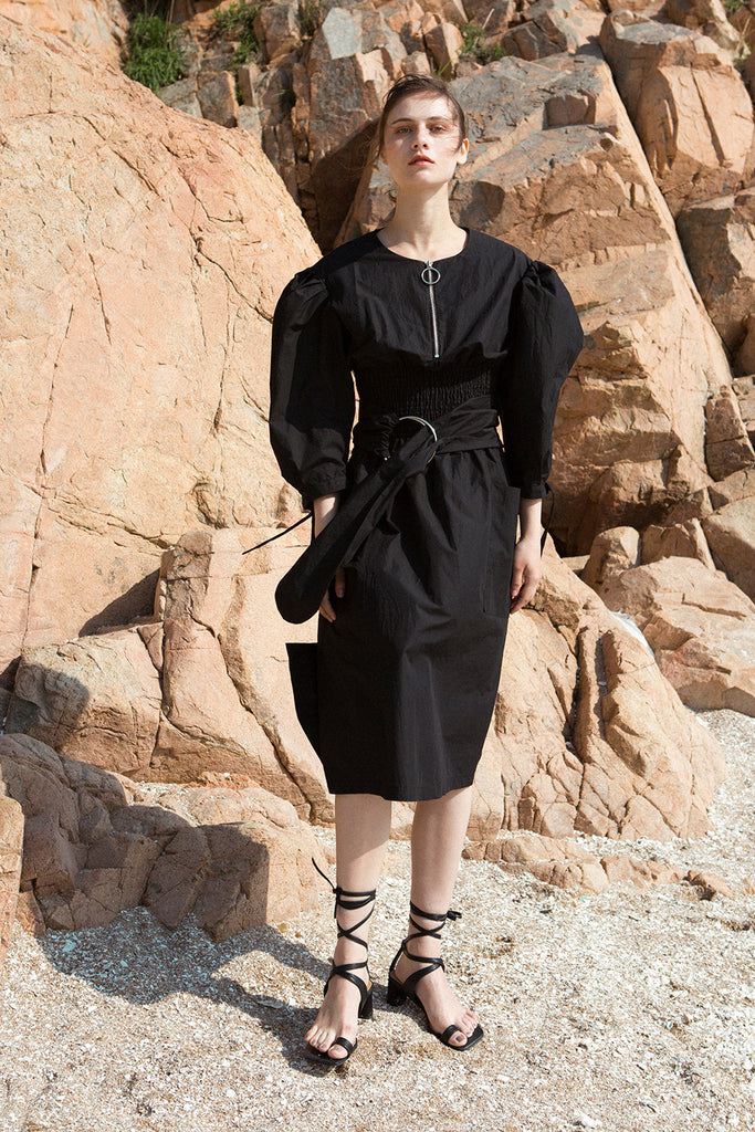 The Myrtle Dress in Black featuring scoop neckline, three-quarter ballon sleeves. Corset-inspired gathered elastic waistline with detachable self-tie fastening belt.