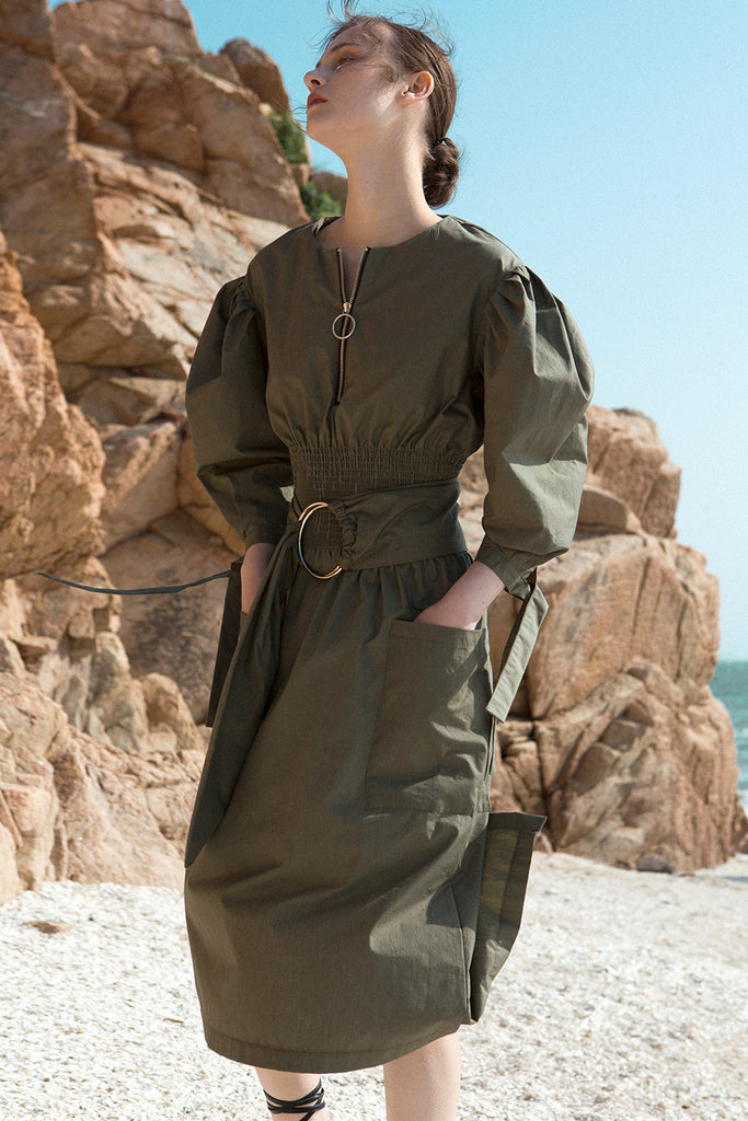 The Myrtle Dress in Khaki featuring scoop neckline, three-quarter ballon sleeves. Corset-inspired gathered elastic waistline with detachable self-tie fastening belt.