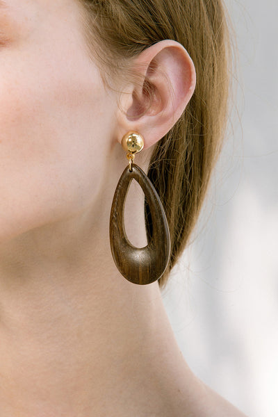 The Nirav, a pair of water drop shaped earring in wood. Gold metal post back. Sold as a set.