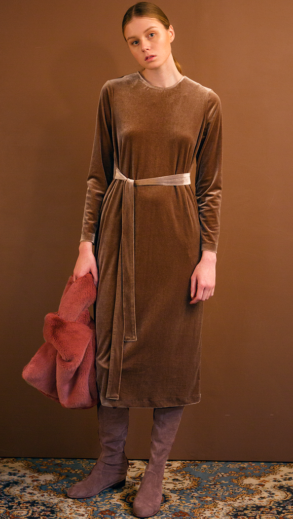 The Palma Dress in lustrous velvet brown. With round neckline, concealed zipper closure at back, long sleeves, attached self-tie strap. Relaxed fit. Stretchy fabric.
