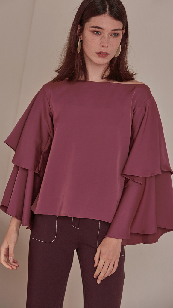 Rocha Top in Wine. Silky-Soft feel. Wide neckline with tiered ruffles along the voluminous sleeves. Round hem. Pull on. Designed to frame shoulders. Cut for a loose fit.