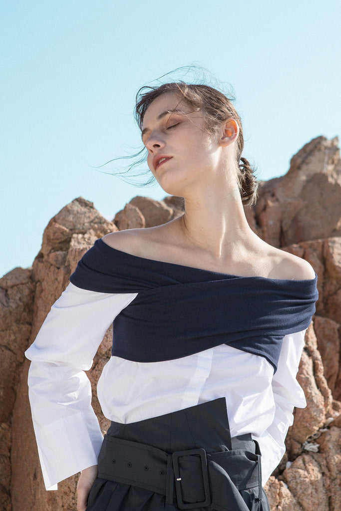 The Roio Top featuring off-the-shoulder neckline with button-down shirt and long sleeves.