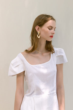 The Rosario Top in White featuring square neckline, cap short sleeves. Pull on. Relaxed fit.