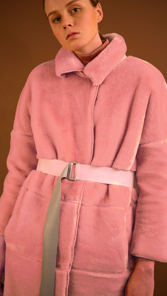 Rosaura Shearling Coat in pink. Super soft, notched collar, dropped shoulder, long sleeve. Snap-button closure at front. Detachable self-tie belt without loops, two slant pockets. Fully lined. Relaxed silhouette.