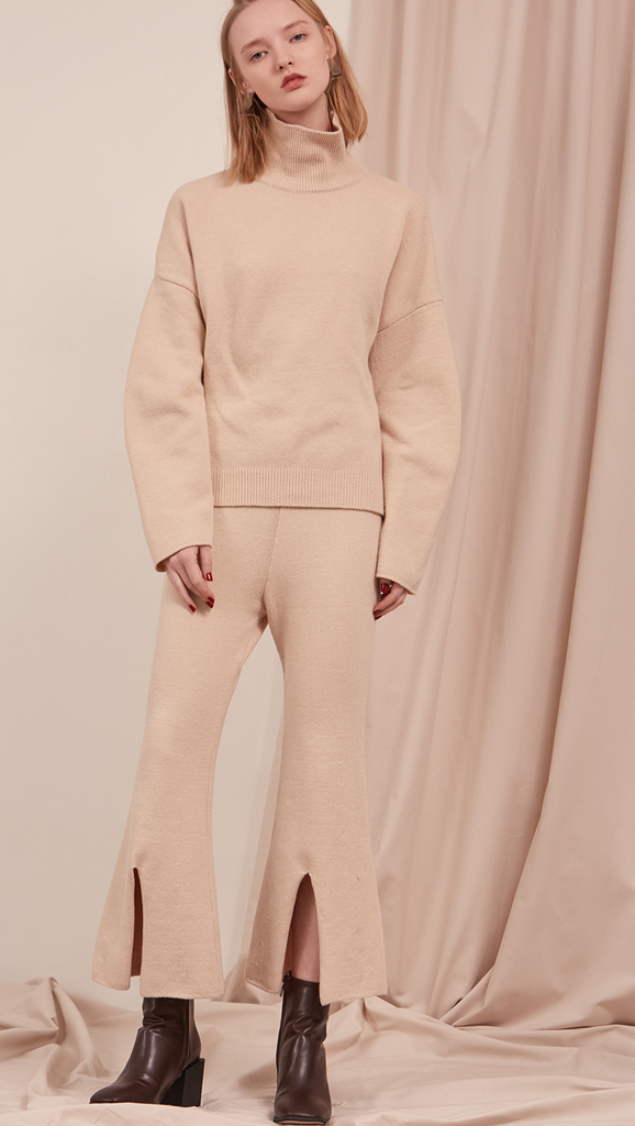 Roscoe Knit in Cream Beige. Oversized sweater with turtleneck, drop shoulder. Pull on.