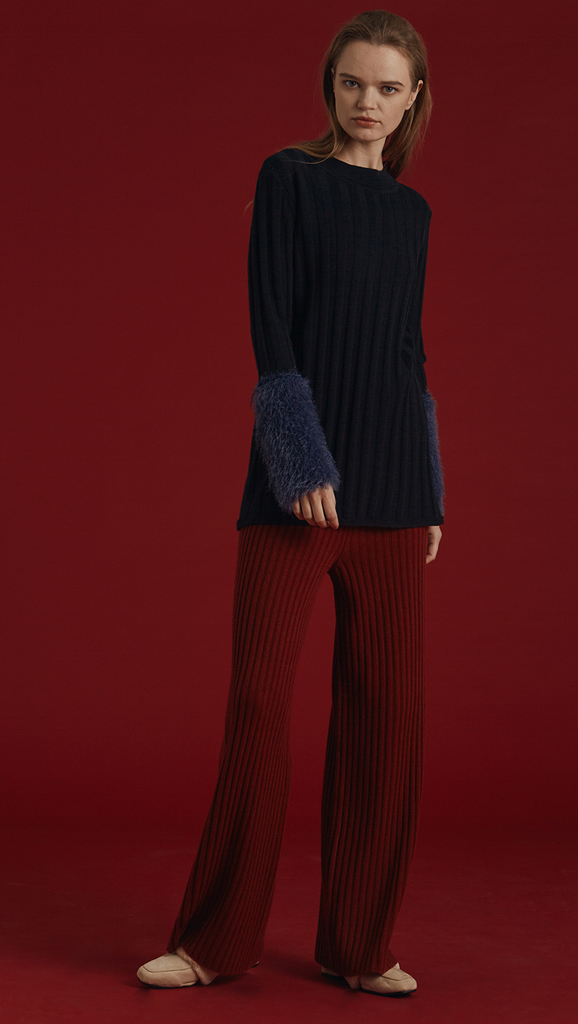 The Mikaela Pant is brick wool trousers sit high on the waist with an elasticated ribbed-knit trim. Wide leg cut. Extra long in length. No pockets. Warm and super soft wool fabric. Relaxed fit. Wholegarment Made.