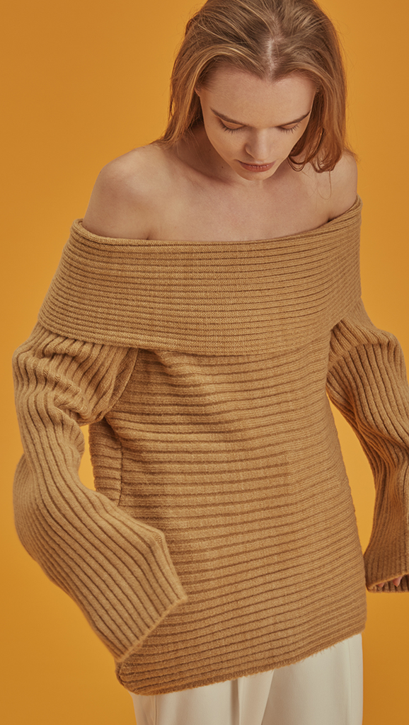 Long sleeved pullover with off-the-shoulder in camel. Soft feel texture. Pull on.
