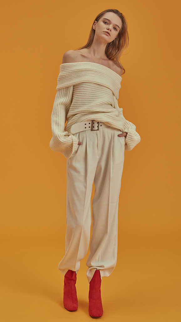 Willow Pant, a detachable belted wide leg trouser in ivory. High waisted raglan pleated, wide belt, particularly long in length, two front pockets. Designed to be straight.
