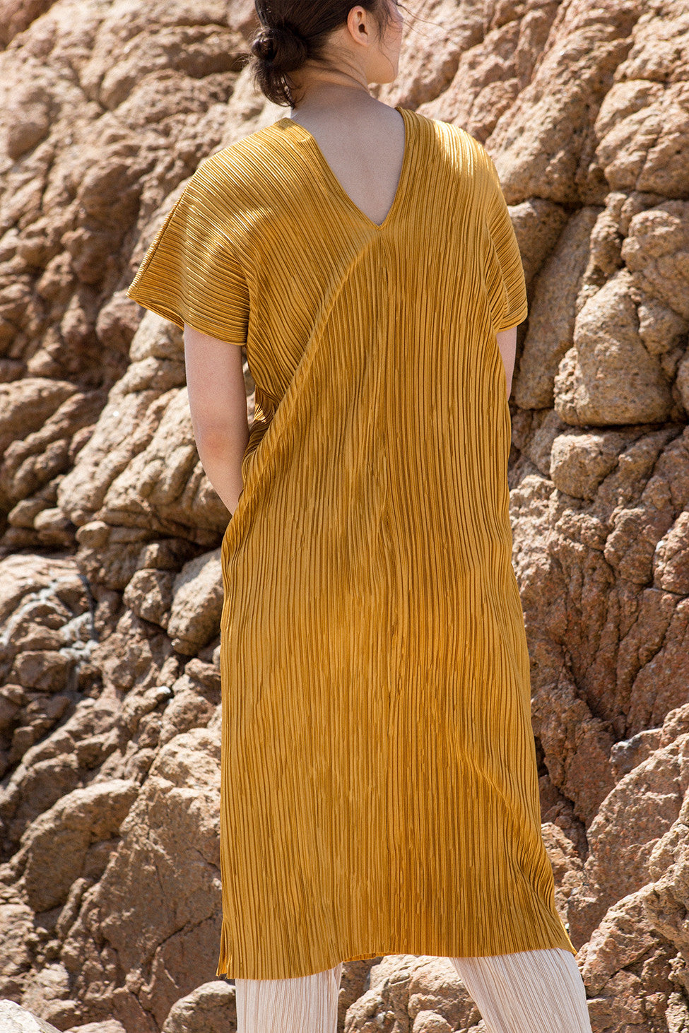 The Rossellini pleats dress in Mustard, featuring v-neckline, cap short sleeves. Pull-on design.