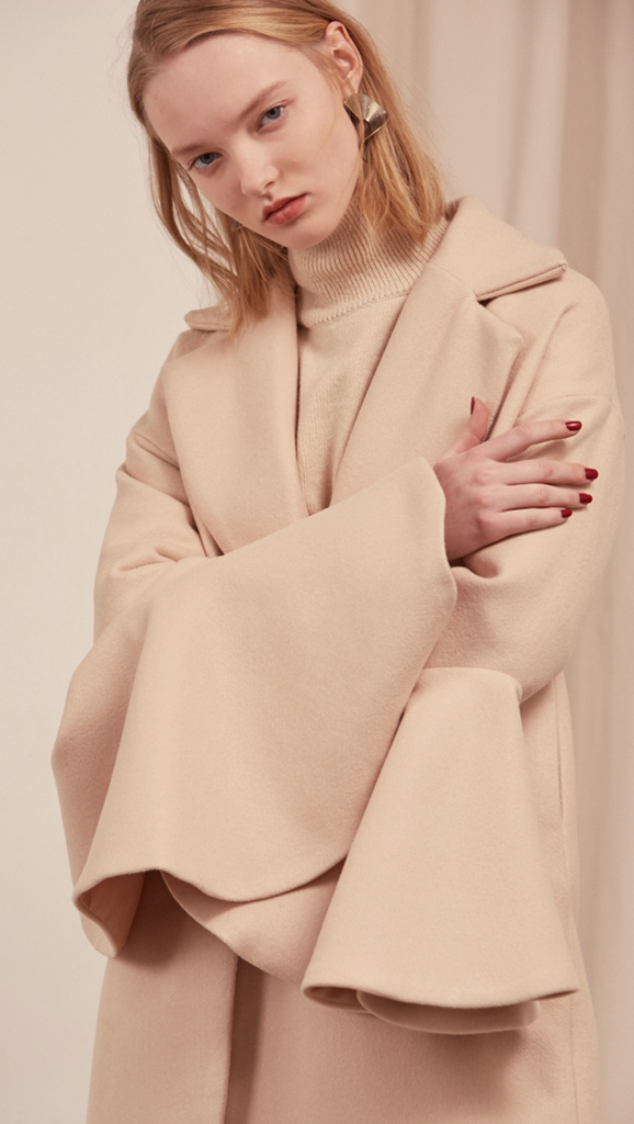 The Ruliette coat styled with gathered wide flare sleeves. With raw-edge ruffled puff sleeves, oversized felt-faced point collar, convertible notch lapel, back drop shoulders, one button closure at front, on-seam vertical slip pockets. Fully lined. Mid-weight.