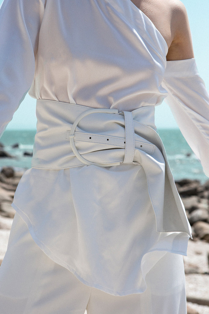 A Russell Belt in White. Self-tie closure.