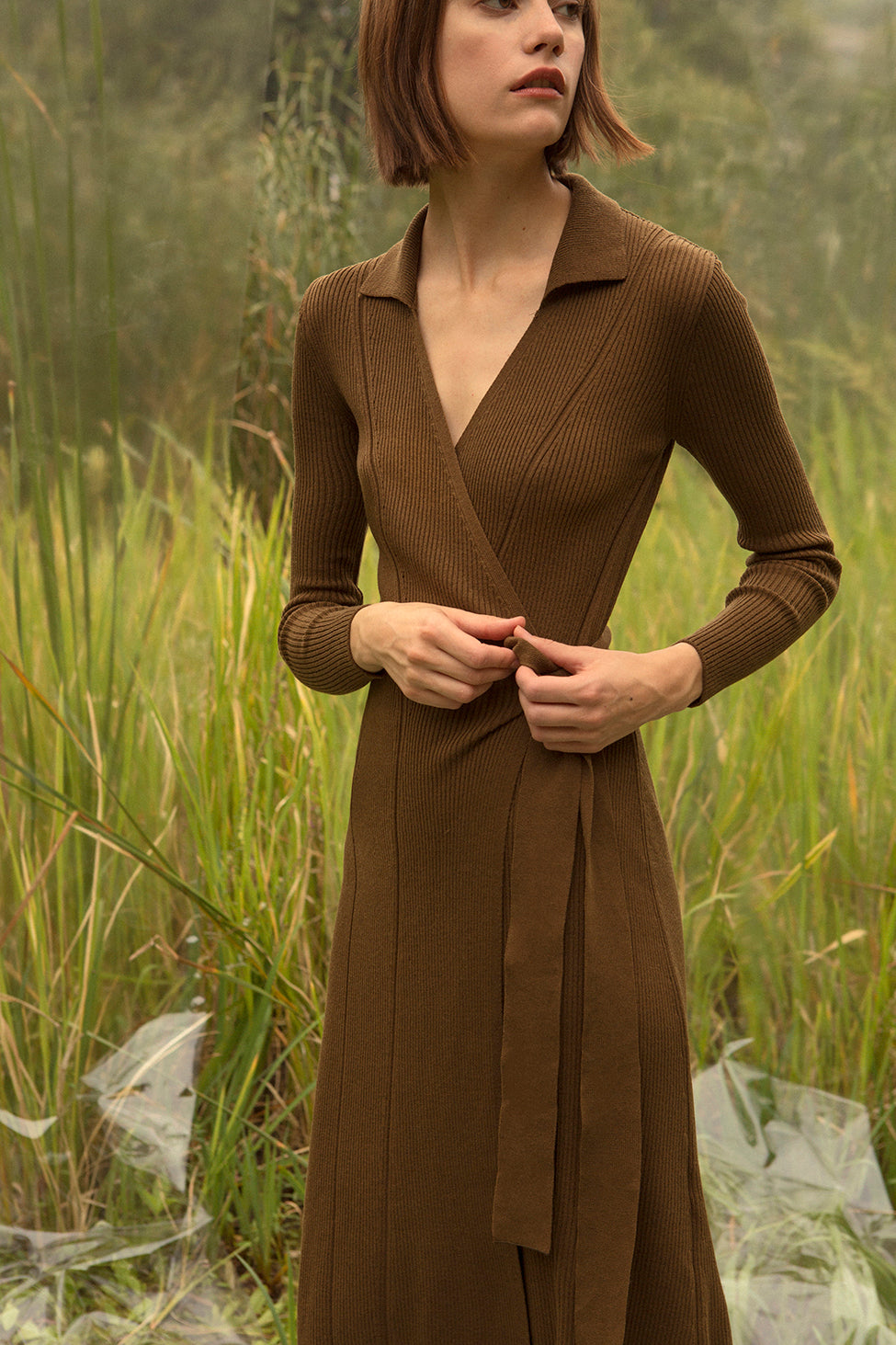 Wrap dress with deep V neckline with shawl collar. Long sleeves. Wrap front with self-tie closure at front. Full skirt. Unlined. Medium weight.