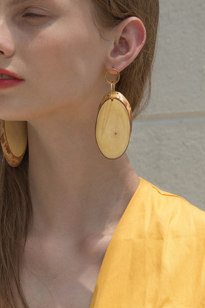 The Siesta, a pair of bamboo earring in cylinder-shaped. Gold metal post back. Sold as a set.