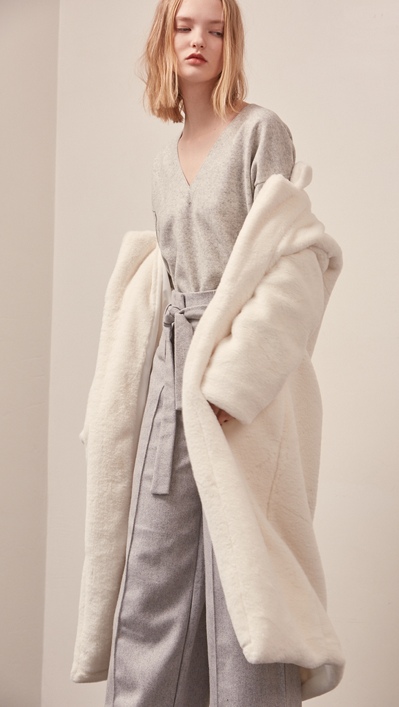 Stelen Shearling Coat in white. Super soft, notched collar, dropped shoulder, long sleeve. Open front. Fully lined. Relaxed silhouette.