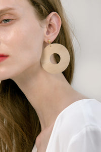 The Taza, a pair of round bamboo earrings. Gold metal post back. Sold as a set.