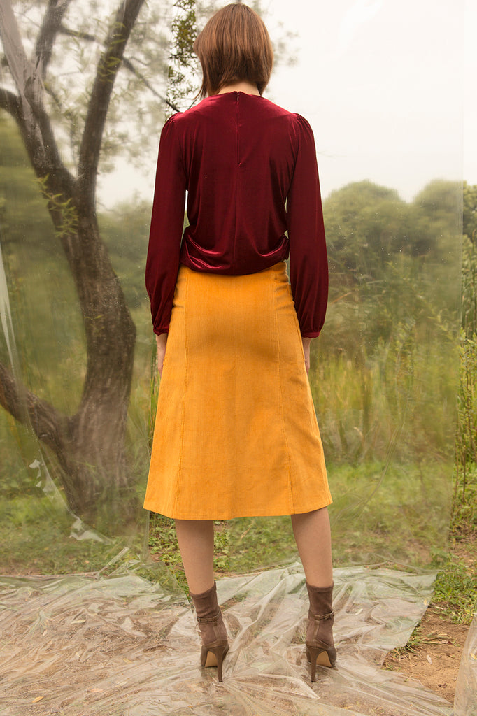 Mid length skirt with center zip fastening detailing. Fitted through hips. A-line silhouette.