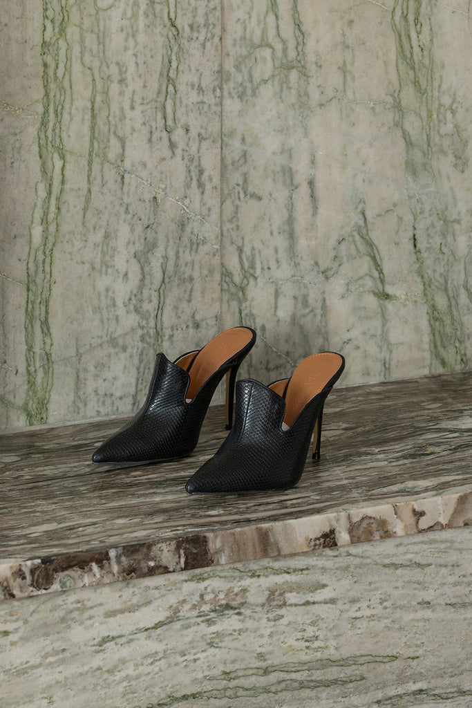 The Vavarta heel in Black. Almond toe. Slip-on design.