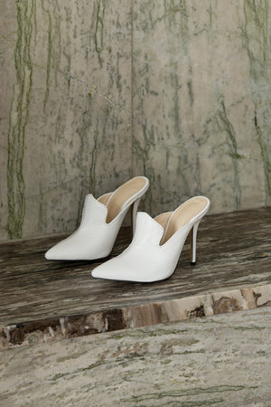 The Vavarta heel in White. Almond toe. Slip-on design.