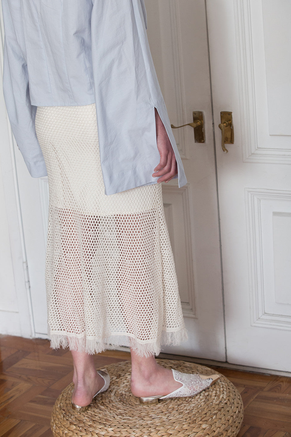 The Veste Skirt in Cream Ivory featuring elasticated waistband with net detailing. Tassel edged. Partial lined.