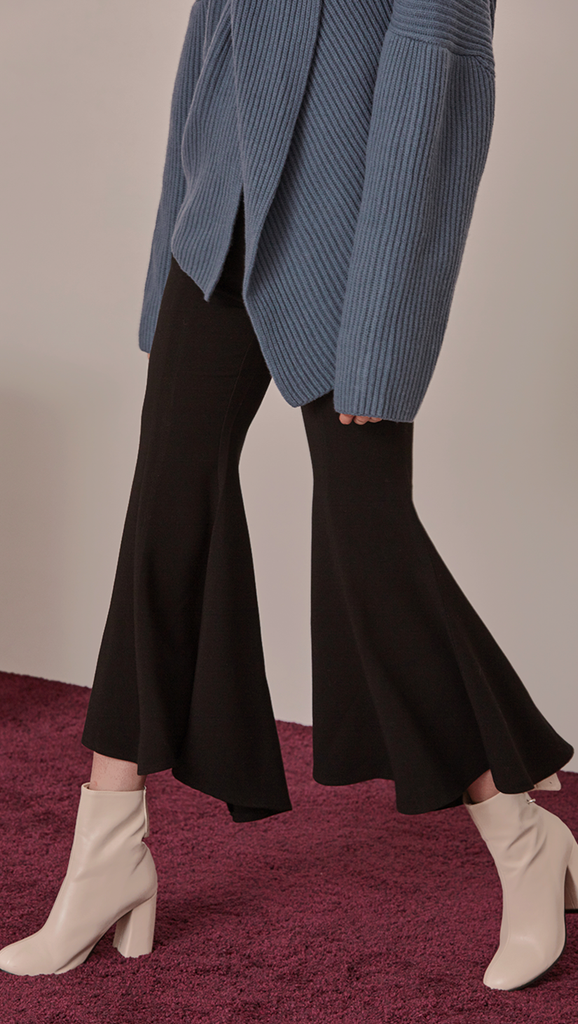 Asymmetric edged peplum leg pant. Centre-front concealed zip fastening along side. No pockets. Slim-fitting at thigh. Gently flare out hem. Designed for high-rise cut. Mid rise with a wide frayed leg.