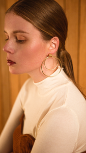 The Yuko, a pair of double layered circle earring. Post back.